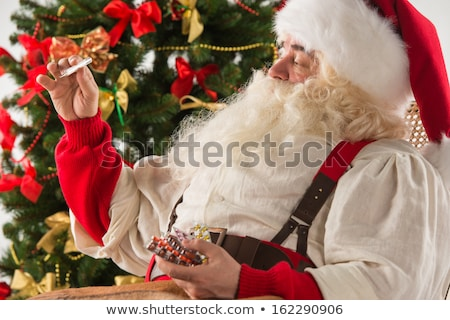 Astonished Santa Claus measuring his temperature Stock photo © HASLOO