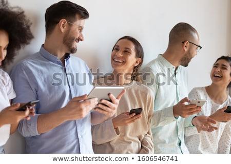 Stockfoto: Groep · toevallig · mensen · praten · mobiele · telefoons · naar