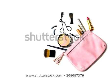 Beautiful golden makeup bag and cosmetics isolated on white  Stock photo © tetkoren