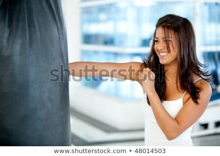 Young Attractive Female Punching Stock photo © AndreyPopov