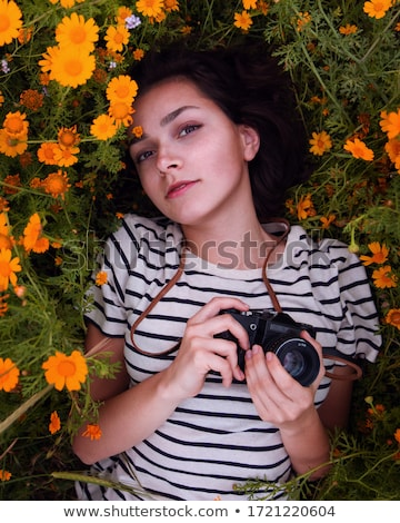 pretty female photographer outdoors on a lovely spring day stock photo © lightpoet
