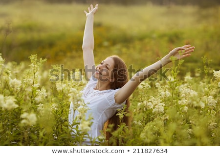 Elated young woman with bouquet of flowers Stock photo © CandyboxPhoto