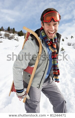 Young Man Carrying Sled In Alpine Landscape Stock photo © monkey_business
