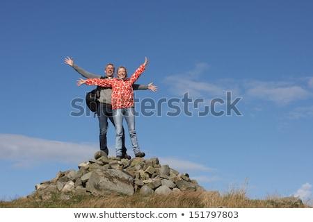 male walker standing on pile of rocks stock photo © monkey_business