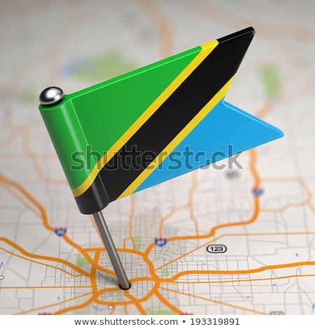 Tanzania Small Flag on a Map Background. Stock photo © tashatuvango