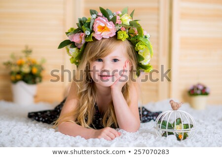 Healthy girl with a birdcage and flowers stock photo © Kor