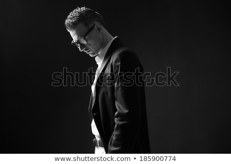 Black and white photo of a pensive businessman in glasses Stock photo © deandrobot