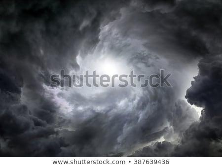 dark stormy sky with light breaks in the clouds stock photo © tuulijumala