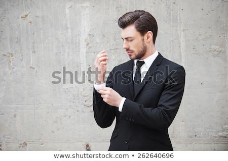 молодые деловой человек одевание изолированный белый бизнеса Сток-фото © hsfelix