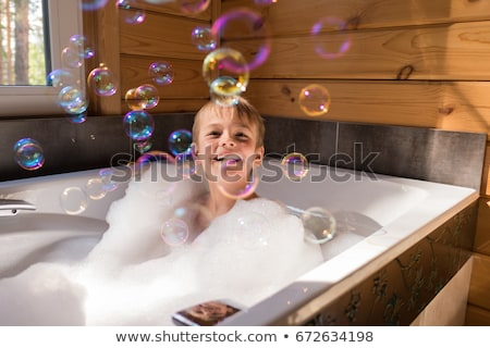 Bathing child..Small child in bath Stock photo © fanfo