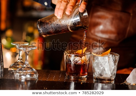 Stockfoto: Bartender Pouring Cocktail Into Glasses