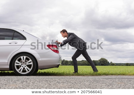 Vista lateral empresario empujando blanco negocios empresarial Foto stock © wavebreak_media