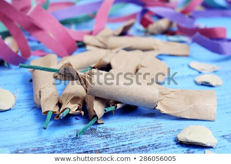 streamers, confetti and firecrackers on a rustic blue wooden sur Stock photo © nito