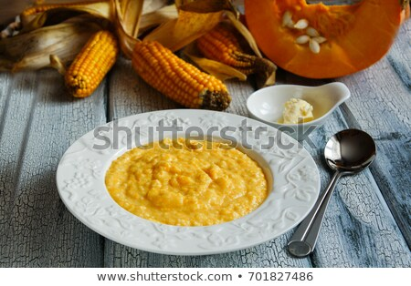 corn porridge with pumpkin on white wooden background stock photo © master1305