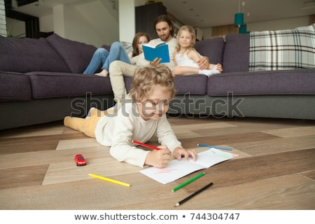 Sweet Couple Resting on Couch While Reading a Book Stock photo © juniart