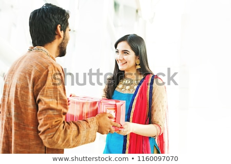 Man giving gift to his wife on Diwali Stock photo © imagedb
