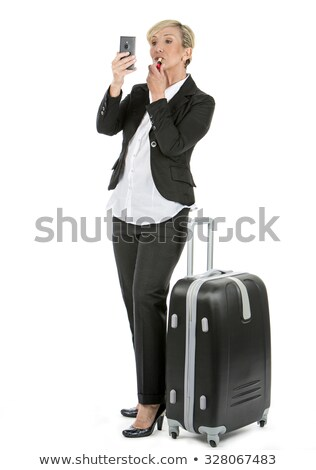 woman manager with trolley getting lipstick Stock photo © Flareimage