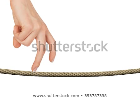 Womans fingers walking on rope with sign Stock photo © cherezoff