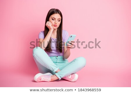 Bored female hipster sitting on the floor Stock photo © deandrobot