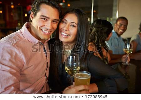 Smiling friends embracing at nightclub Stock photo © wavebreak_media