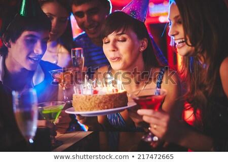 Mujer fuera velas de cumpleaños amigos restaurante Foto stock © wavebreak_media