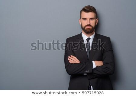 Adam siyah takım elbise bakıyor doğru tam uzunlukta portre Stok fotoğraf © filipw