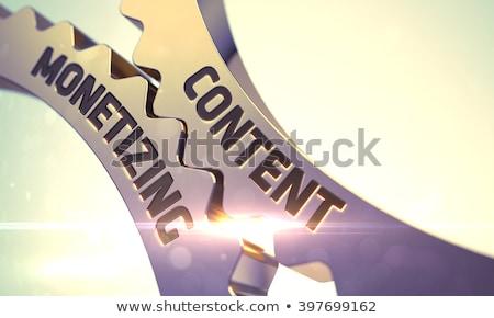 Golden Metallic Cog Gears with Content Marketing Concept. Stock photo © tashatuvango
