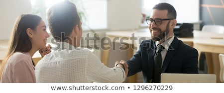 A couple of business suits shaking hands Stock photo © IS2
