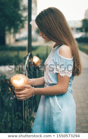 Girl holding a tree in her arms Stock photo © IS2