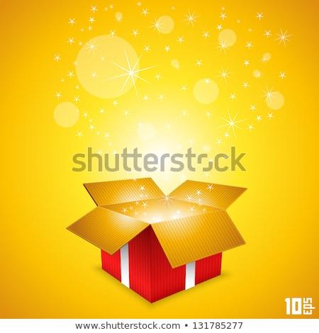 red sunburst background with gift box stock photo © cammep