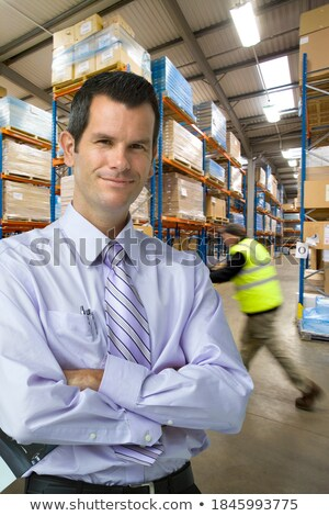 two businessmen in front of storage Stock photo © IS2