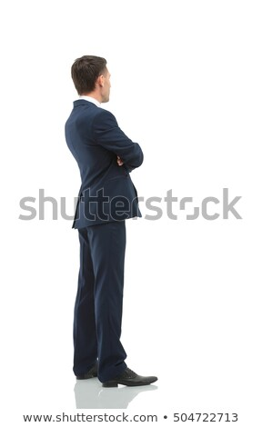 side view of a smiling elegant man with hands crossed stock photo © feedough