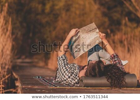 Młoda kobieta koc jezioro wolności wakacje snem Zdjęcia stock © IS2