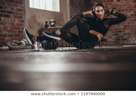 Athlete in sportswear doing crunches Stock photo © wavebreak_media
