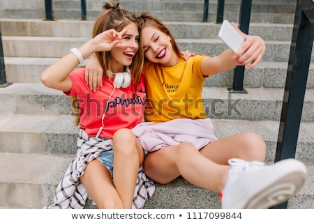 Sisters making peace sign together Stock photo © IS2