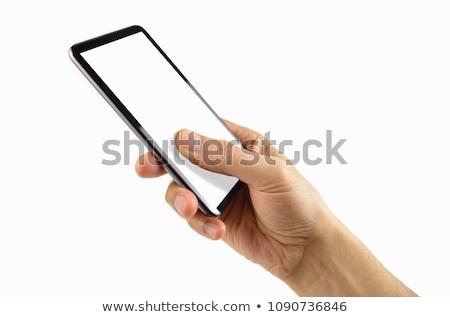 Hand holding mobile phone against white background Stock photo © wavebreak_media