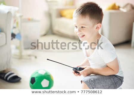 young boy with remote control stock photo © is2