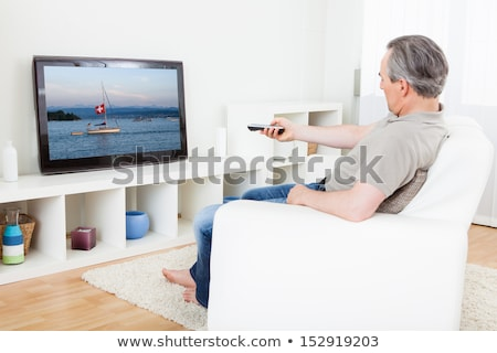 Senior Adult man watching television Stock photo © IS2