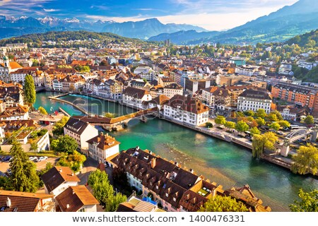 City of Luzern riverfront and rooftops aerial view Stock photo © xbrchx