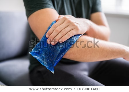 Man Applying Ice Gel Pack On An Ankle Stock photo © AndreyPopov
