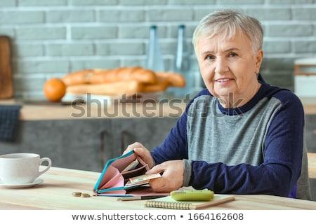 Idős nő pénz otthoni pénzügyek megtakarított pénz biztosítás Stock fotó © dolgachov