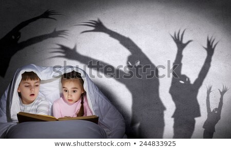 boy reading book with two monsters stock photo © colematt