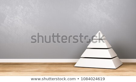 Four Levels White Pyramid on Wooden Floor Against Wall Stock photo © make