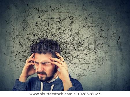 Figyelmes hangsúlyos férfi rendetlenség fej fiatalember Stock fotó © ichiosea