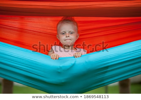 Happy Little Girl Lying On Hammock At Beach Stock photo © AndreyPopov