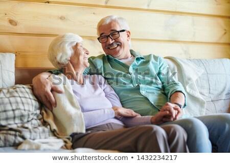 Alegre pareja de ancianos noticias planes relajante Foto stock © pressmaster
