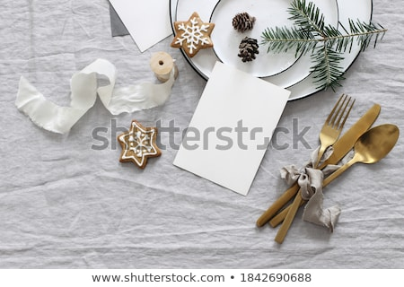 Christmas flat lay scene with golden decorations Stock photo © neirfy