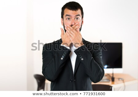 shocked man closing mouth by hands at office room Stock photo © dolgachov