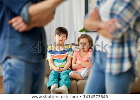 children watching their parents quarreling at home Stock photo © dolgachov