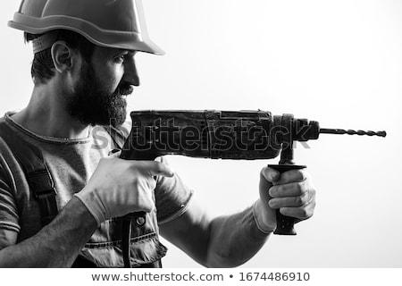 genç · ciddi · işçi · matkap · adam · kâğıt - stok fotoğraf © elly_l